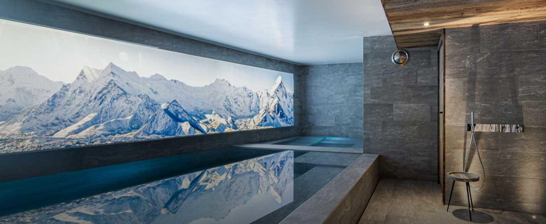 location chalet prestige; Orca; vue panoramique sur les Alpes Française; vue unique; chalet somptueux et spacieux; charme rustique; design;hammam; piscine intérieur